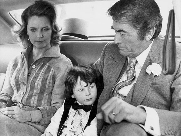 """Lee Remick, Gregory Peck, and Harvey Stephens, in a scene from the 1976 movie """"The Omen.""""   Photo: Getty Images"""
