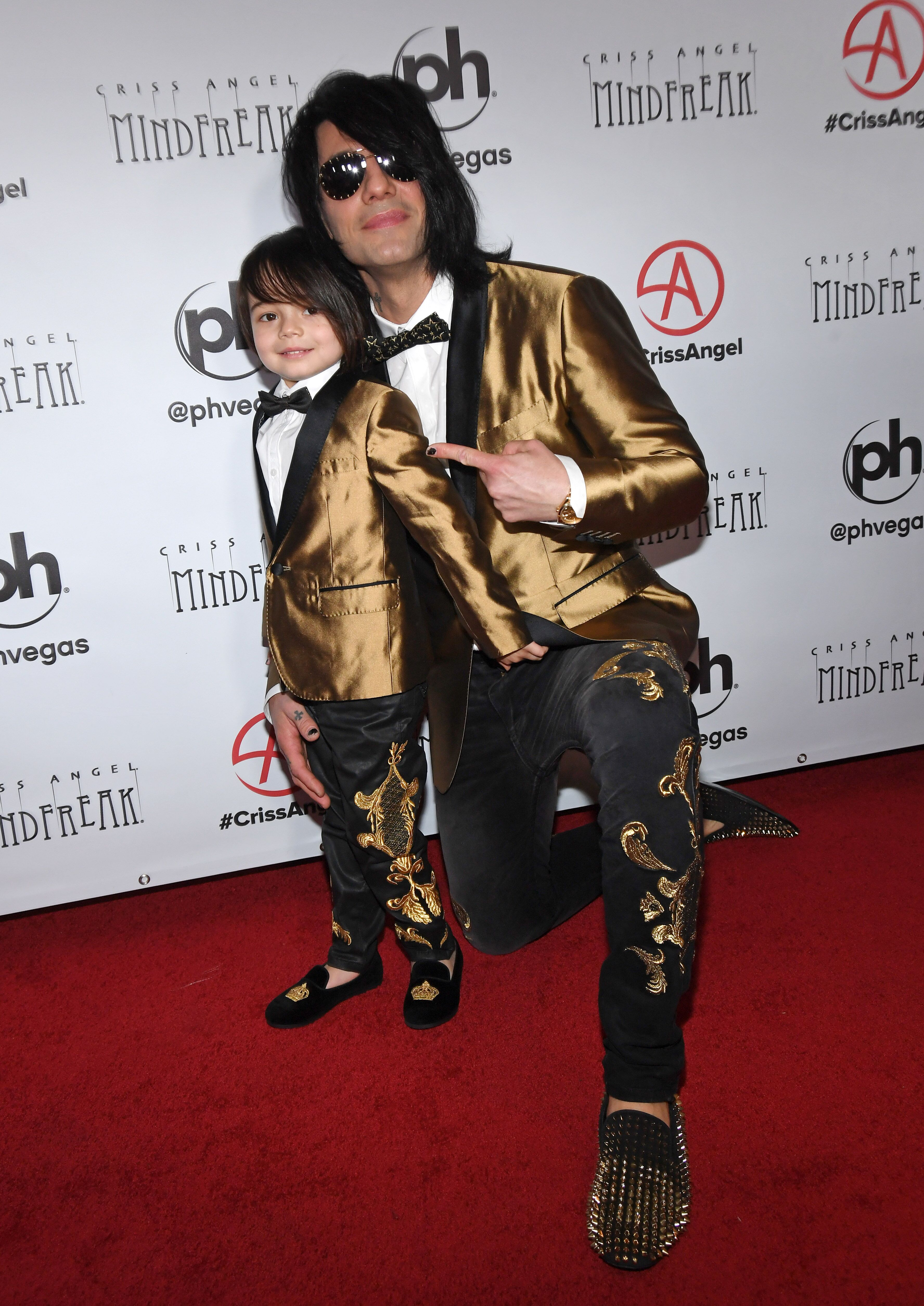 "Criss Angel land son Johnny Crisstopher at the grand opening of ""Criss Angel MINDFREAK"" at Planet Hollywood in January 2019 