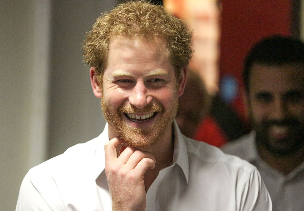 Prince Harry smiles during a visit to the Double Jab Boxing Club to support Sport for Social Development initiatives on June 6, 2016 in London, United Kingdom | Photo: Getty Images
