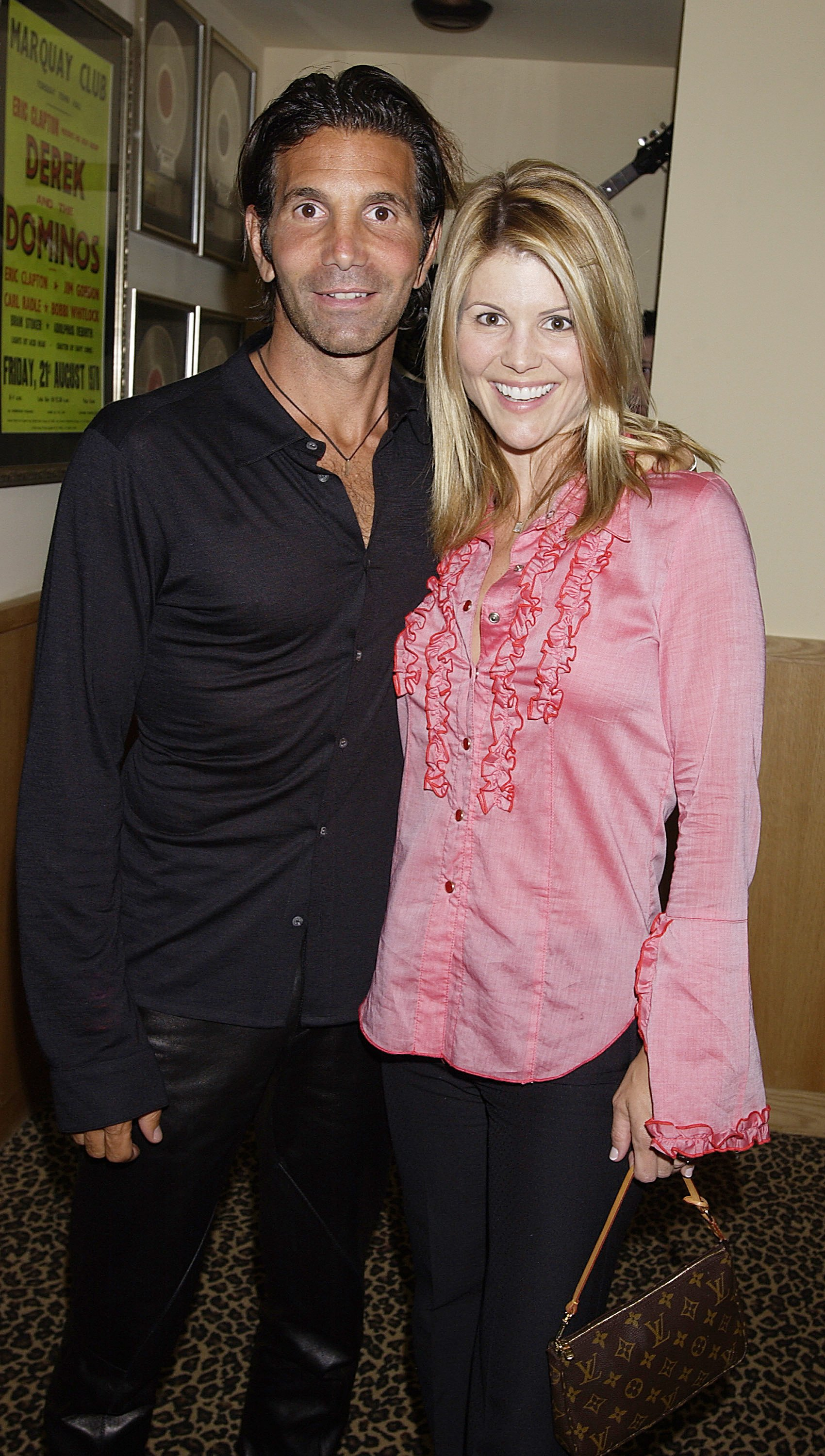 Lori Laughlin and Mossimo Giannulli arrive April 26, 2002 at the Hard Rock Hotel in Las Vegas.   Source: Getty Images