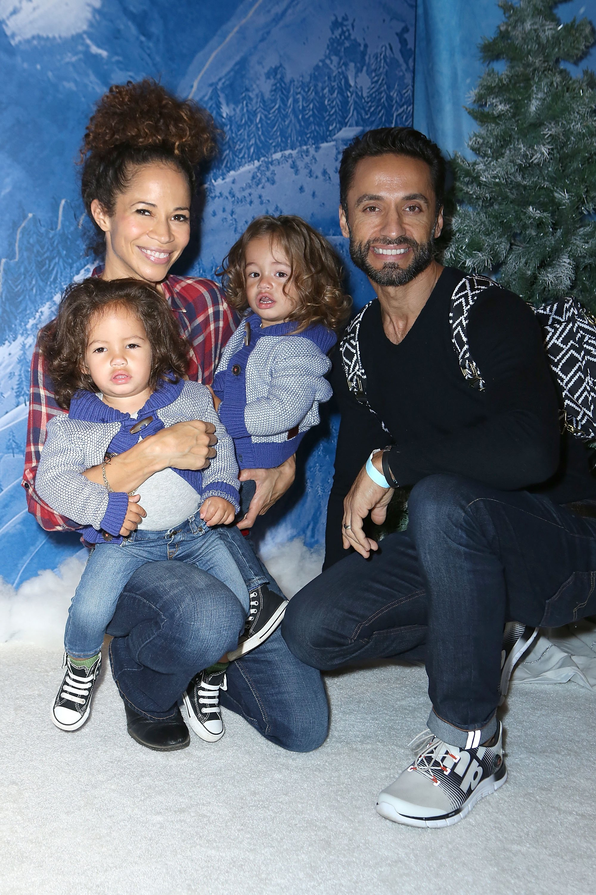 Sherri Saum, John, Michael, and Kamar De Los Reyes attend Disney On Ice Presents Frozen Los Angeles Premiere at Staples Center on December 10, 2015, in Los Angeles, California. | Source: Getty Images.