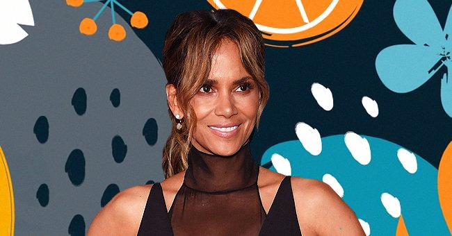 Halle Berry Dons a Hat and Puts Her Long Legs on Display in High-Heeled Boots in a New Video