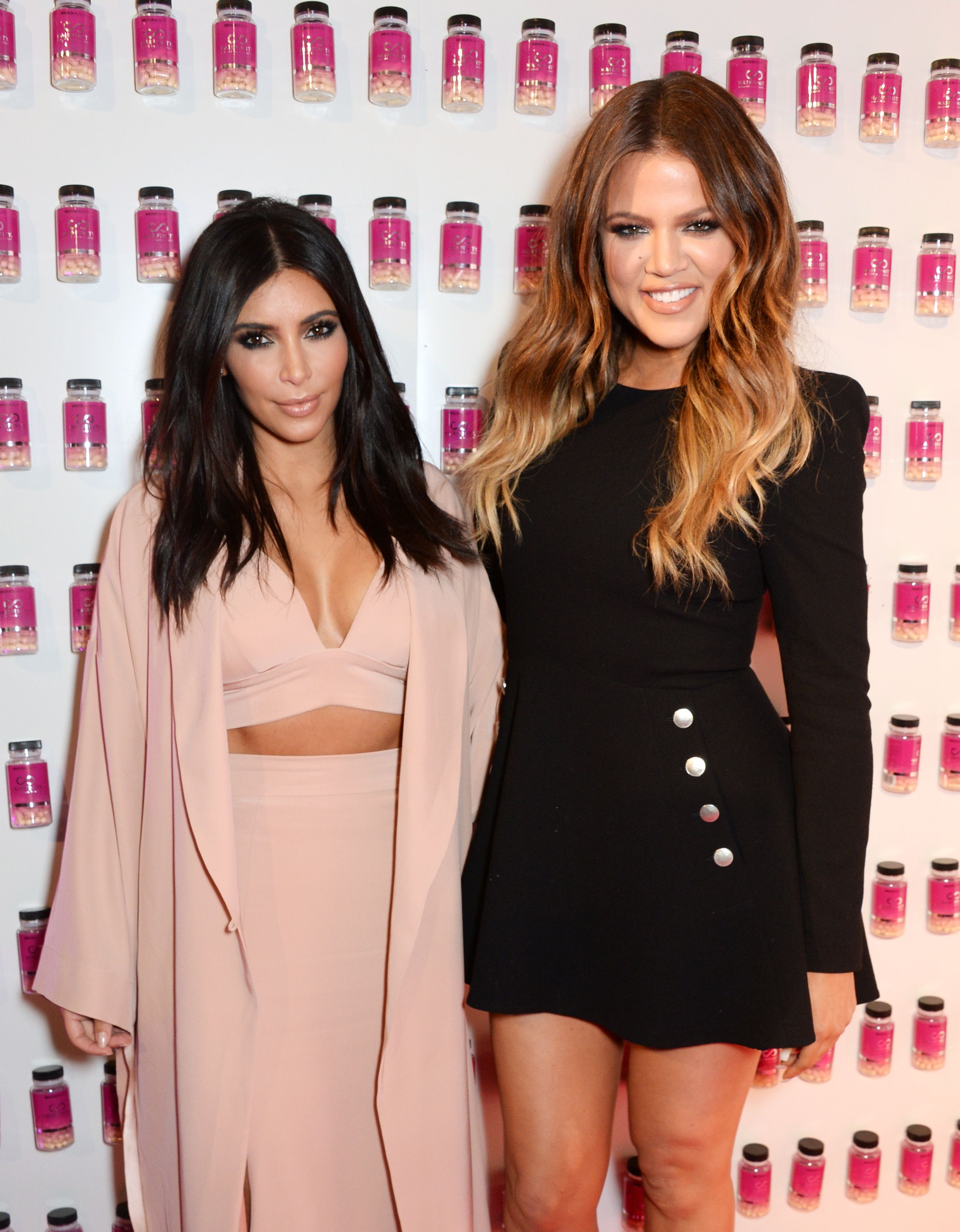 Kim Kardashian West and Khloe Kardashian at the Hairfinity UK Launch as special guests at Il Bottaccio on November 8, 2014   Photo: Getty Images