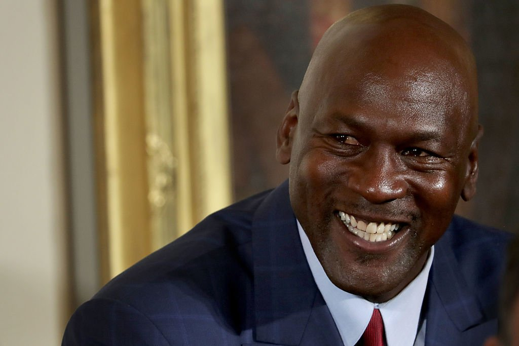 National Basketball Association Hall of Fame member and legendary athlete Michael Jordan smiles before being awarded the Presidential Medal of Freedom by U.S. President Barack Obama during a ceremony in the East Room of the White House on November 22, 2016 | Photo: Getty Images