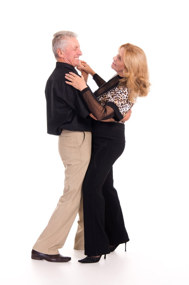 A portrait of a cheerful senior couple dancing. | Photo: Shutterstock
