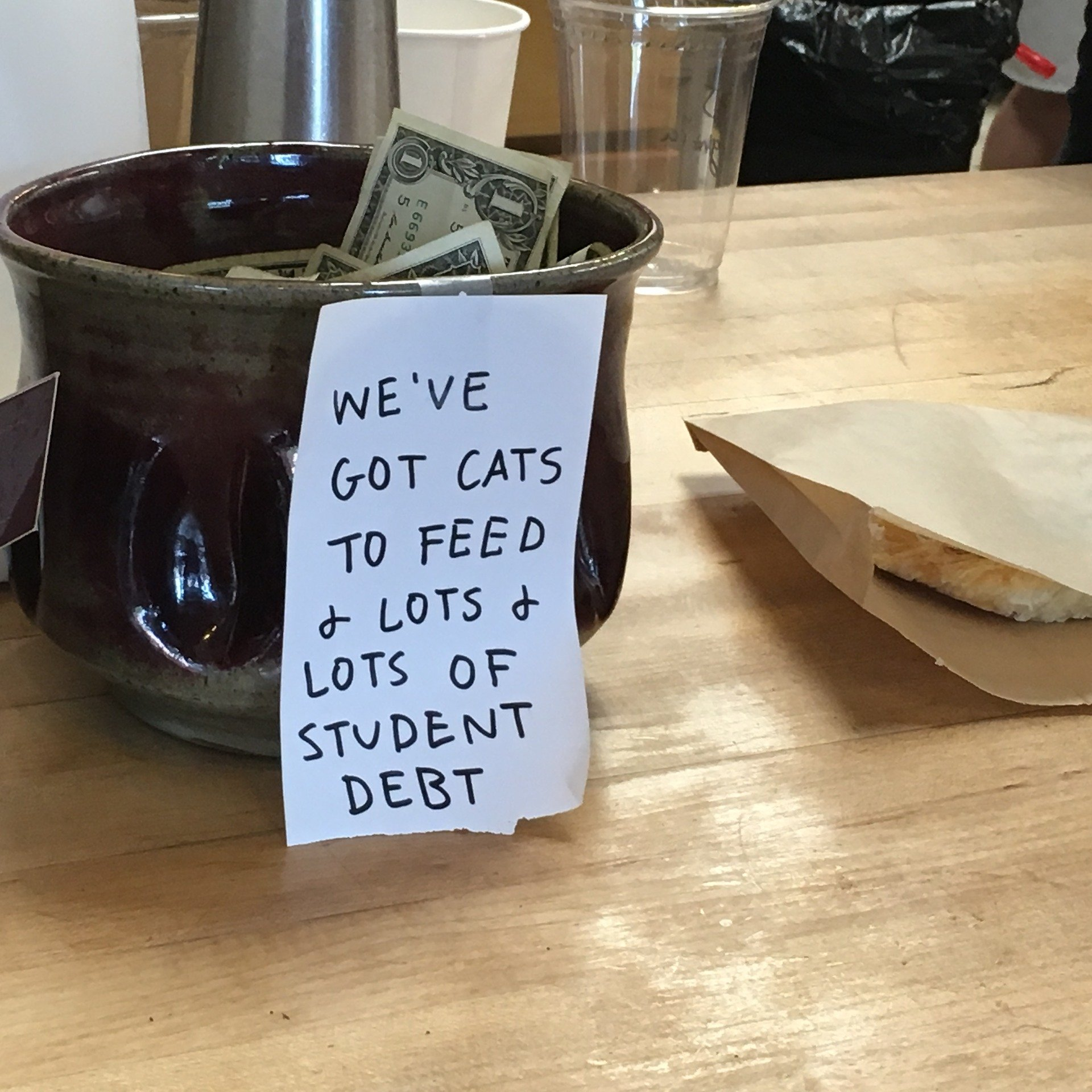 Tip jar at a local diner stuffed with $1 notes. | Source: Pixabay/Tad Hanna