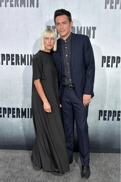 "Nicole Vicius (L) and John Boyd attend the premiere of STX Entertainment's ""Peppermint"" at Regal Cinemas L.A. LIVE Stadium 14 on August 28, 2018, in Los Angeles, California. 