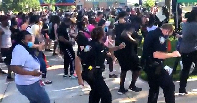 Protesters and Police Officers Dance Together in Support of 'Hold Cops Accountable' Initiative