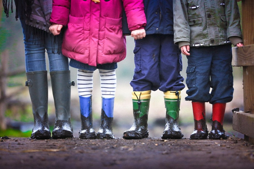 A group of children in galoshes   Source: Unsplash