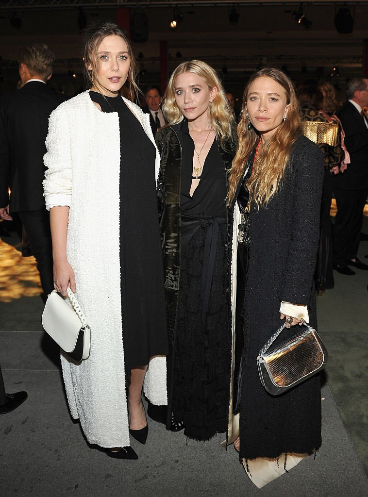 Actresses Elizabeth, Ashley, and Mary Kate Olsen at LACMA on October 29, 2016 in Los Angeles, California | Source: Getty Images