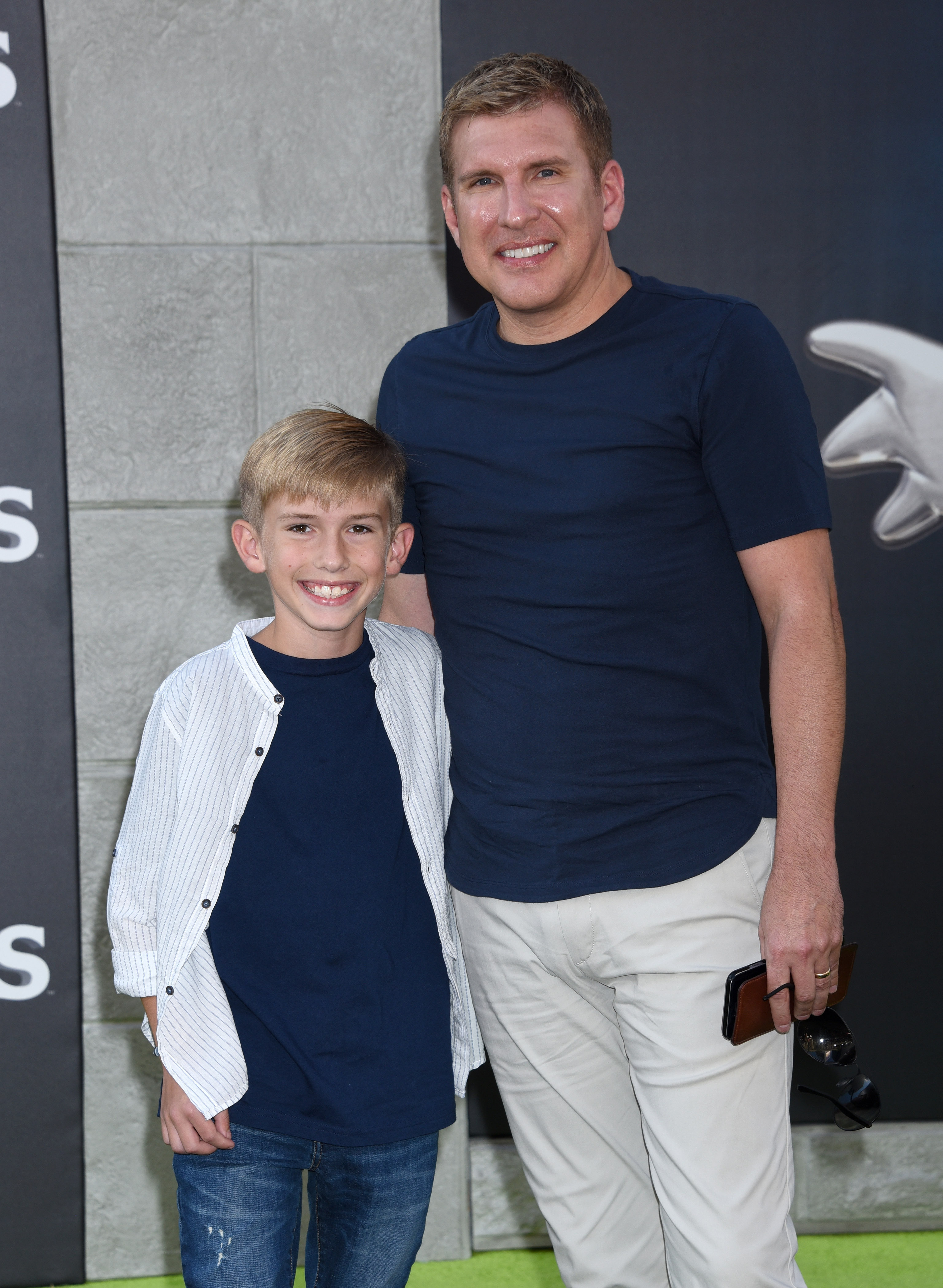 """Todd Chrisley and son Grayson attend the premiere of """"Ghostbuster"""" in Hollywood, California on July 9, 2016 