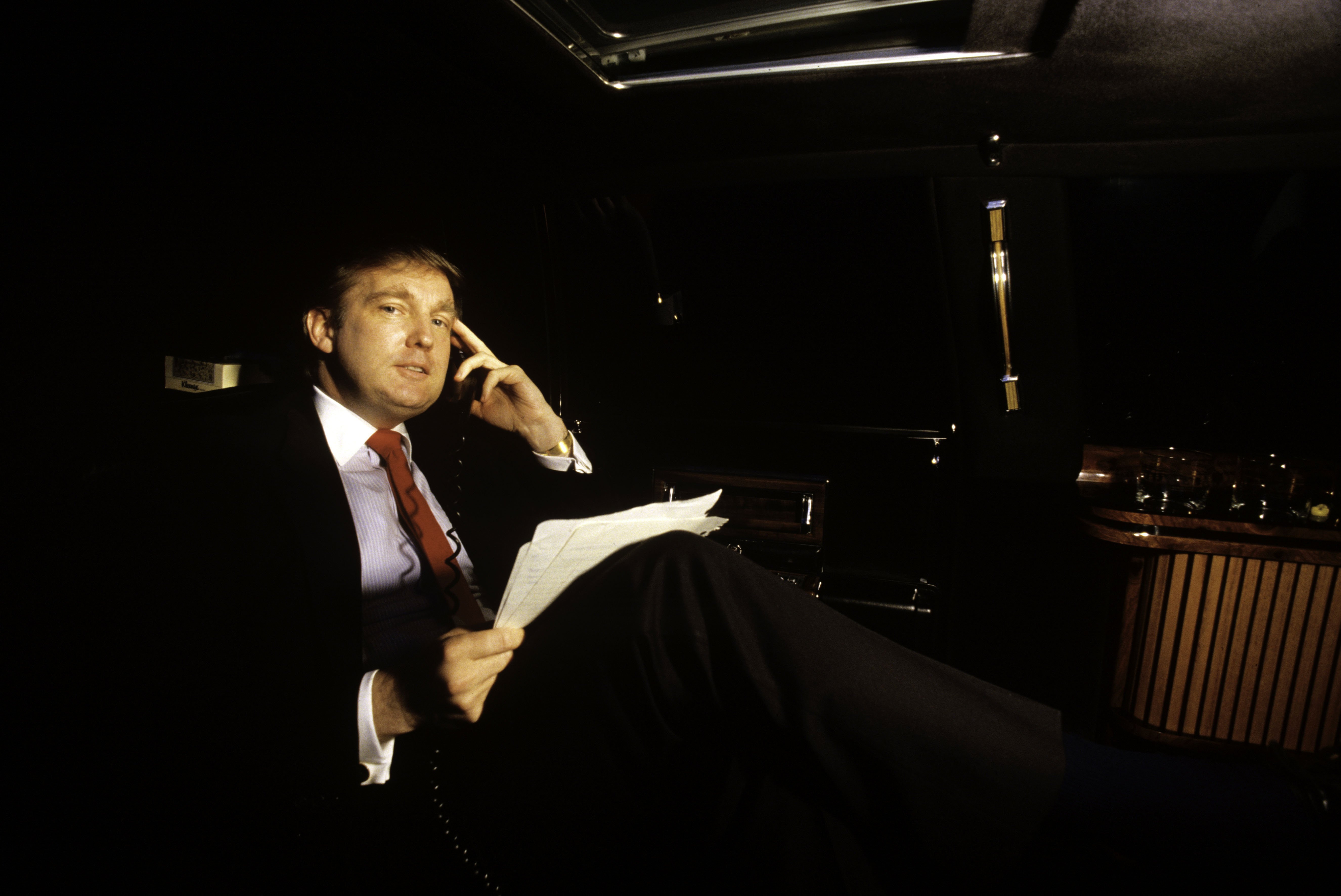 Donald Trump, real estate mogul, entrepreneur, and billionare commutes around New York City in his limousine often using this transportation as an office on August 1987 | Photo: GettyImages