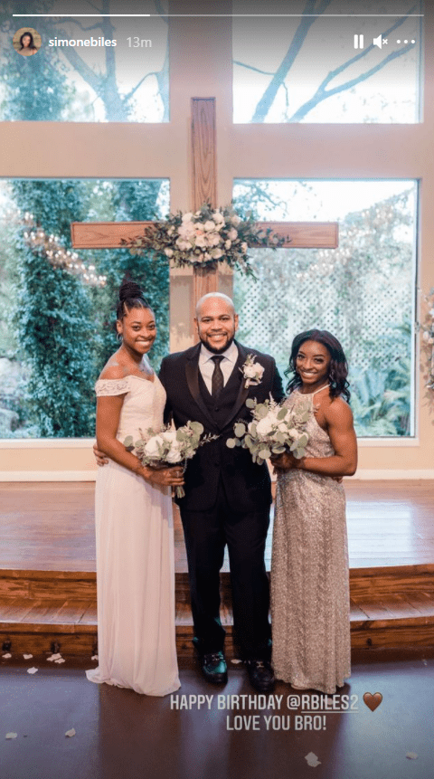 Screenshot of photo of Simone, Ron and Adria Biles posing at Ron Biles' wedding in 2020. | Source: Instagram/simonebiles