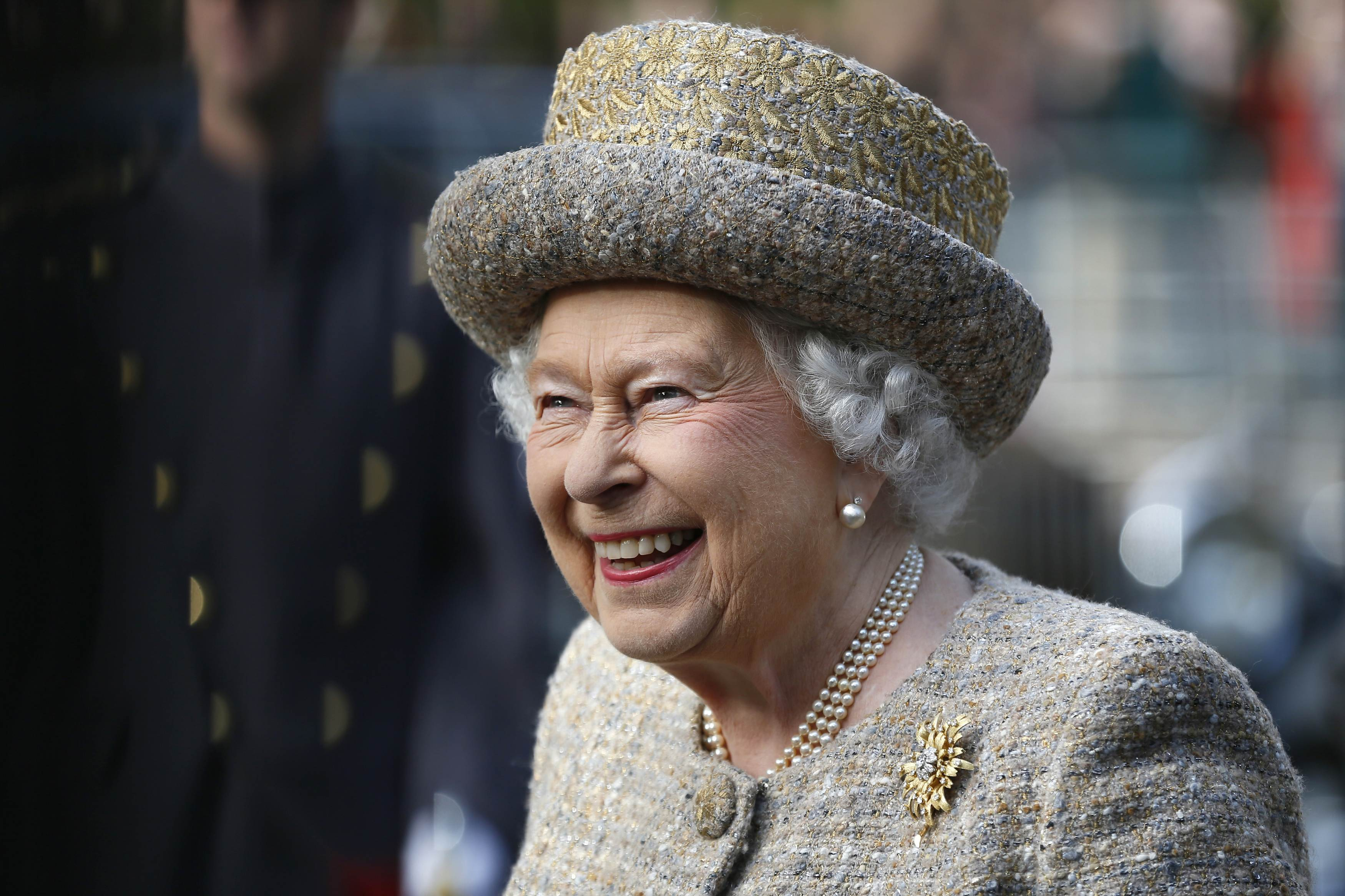 Queen Elizabeth II smiles as she arrives before the Opening of the Flanders' Fields Memorial Garden at Wellington Barracks on November 6, 2014 in London, England   Photo: Getty Images