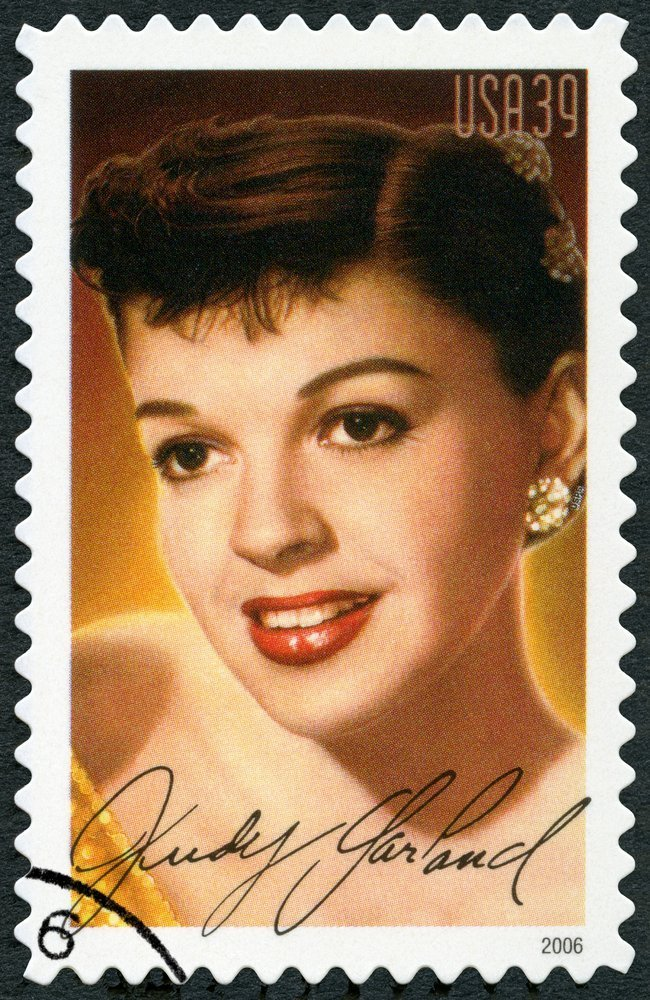 A stamp printed in USA shows portrait Judy Garland (1922-1969) | Olga Popova / Shutterstock.com