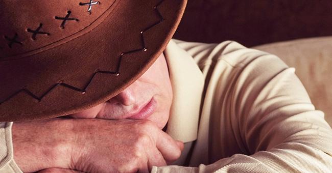 Joke: Usher Gets Annoyed at Seeing a Drunken Cowboy Sprawled across Three Theater Seats