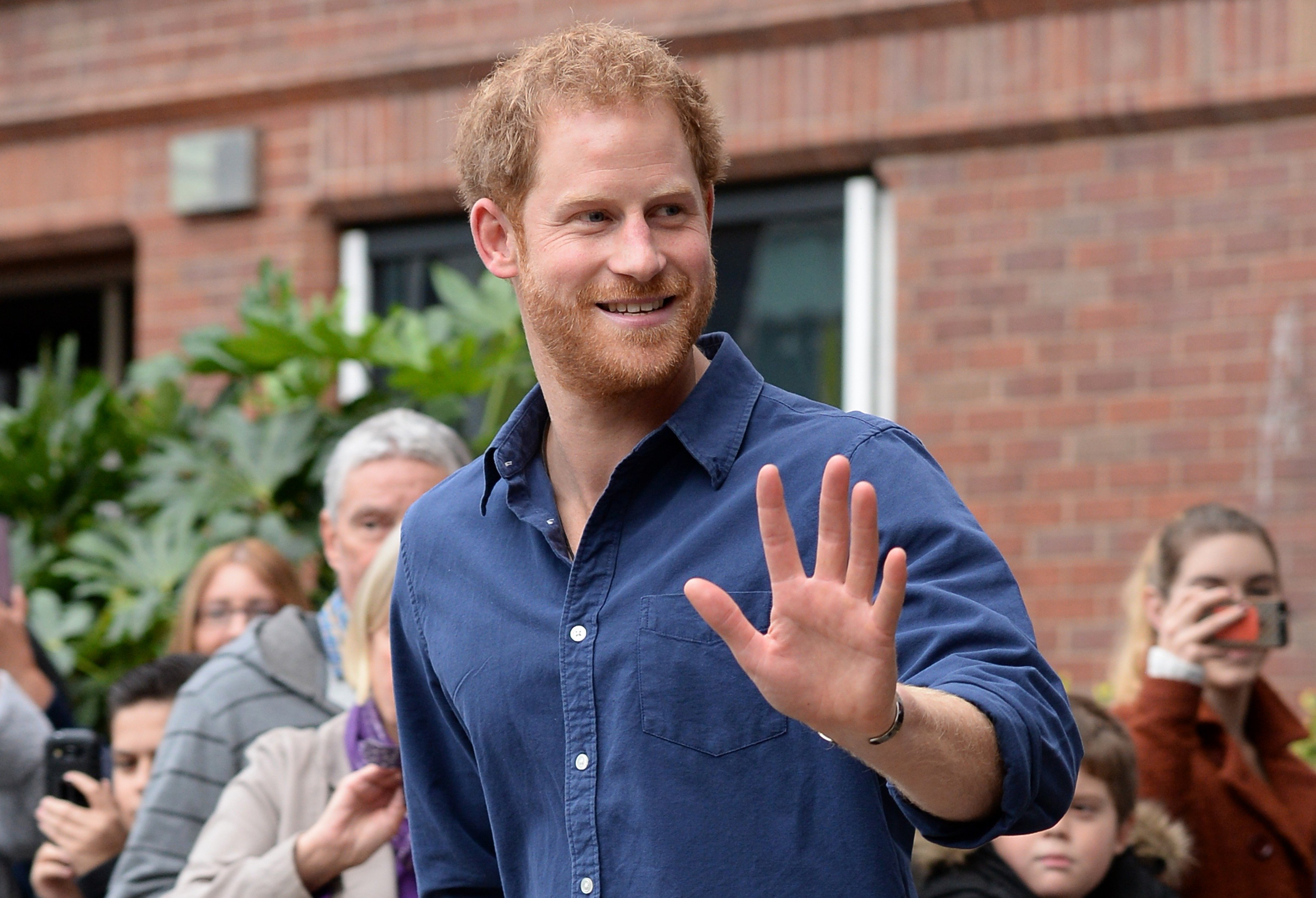 Prince Harry waving while leaving Nottingham's new Central Police Station, 2016, Nottingham, England.   Photo: Getty Images