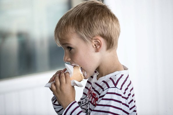 A boy enjoys ice cream offered for free on the Panorama 360 observation deck  Photo: Getty Images