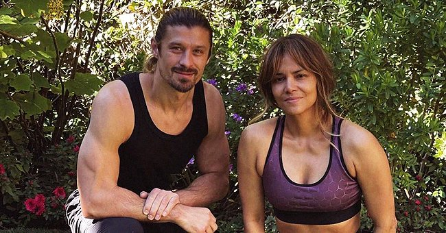 Halle Berry Shows Fit and Strong Body in Purple Top & Matching Leggings in New Photo with Trainer