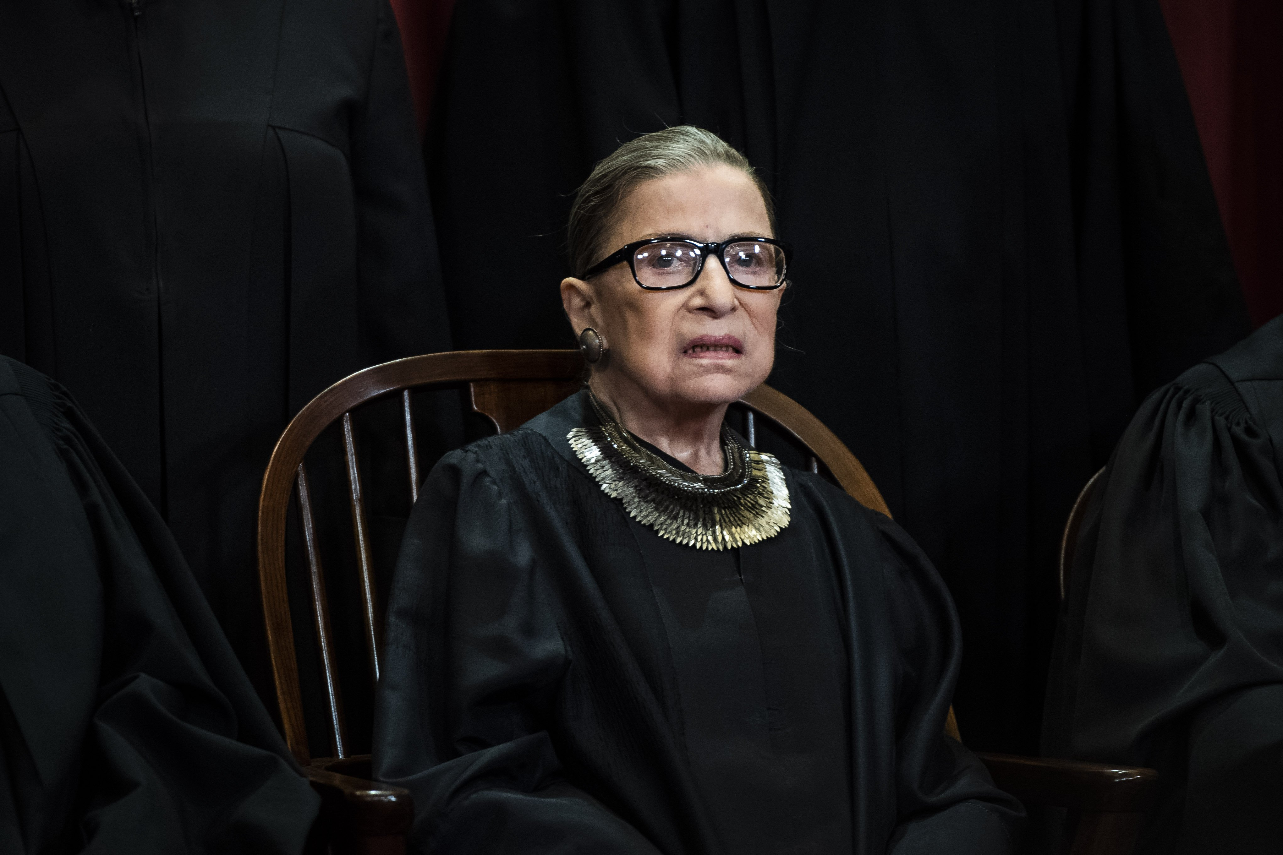 Ruth Bader Ginsburg poses during official group photo at the Supreme Court on Friday, Nov. 30, 2018, in Washington, DC. | Source: Getty Images.