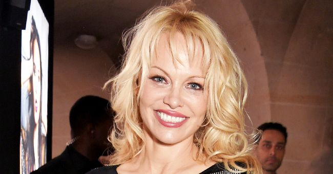 Pamela Anderson, 53, Ditches Her Top and Rocks Sparkly Palazzo Pants in a New Photo