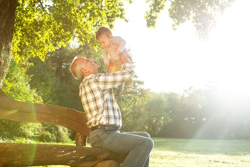 Grandfather playing with his grandchild. | Source: Shutterstock.