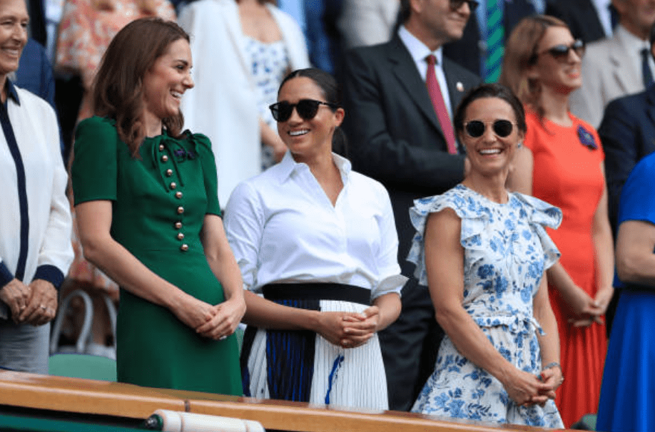Kate Middleton, Meghan Markle and Pippa Matthews laugh together while enjoying a chat in the Royal Box at the Wimbledon Championship on July 13, 2019 in London, England | Source: Simon Stacpoole/Offside/Getty Images