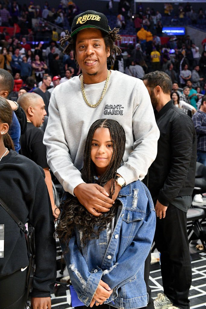 Jay-Z and his daughter, Blue Ivy pose for a photo after the game between the Lakers and the Clippers on March 8, 2020. | Photo: Getty Images