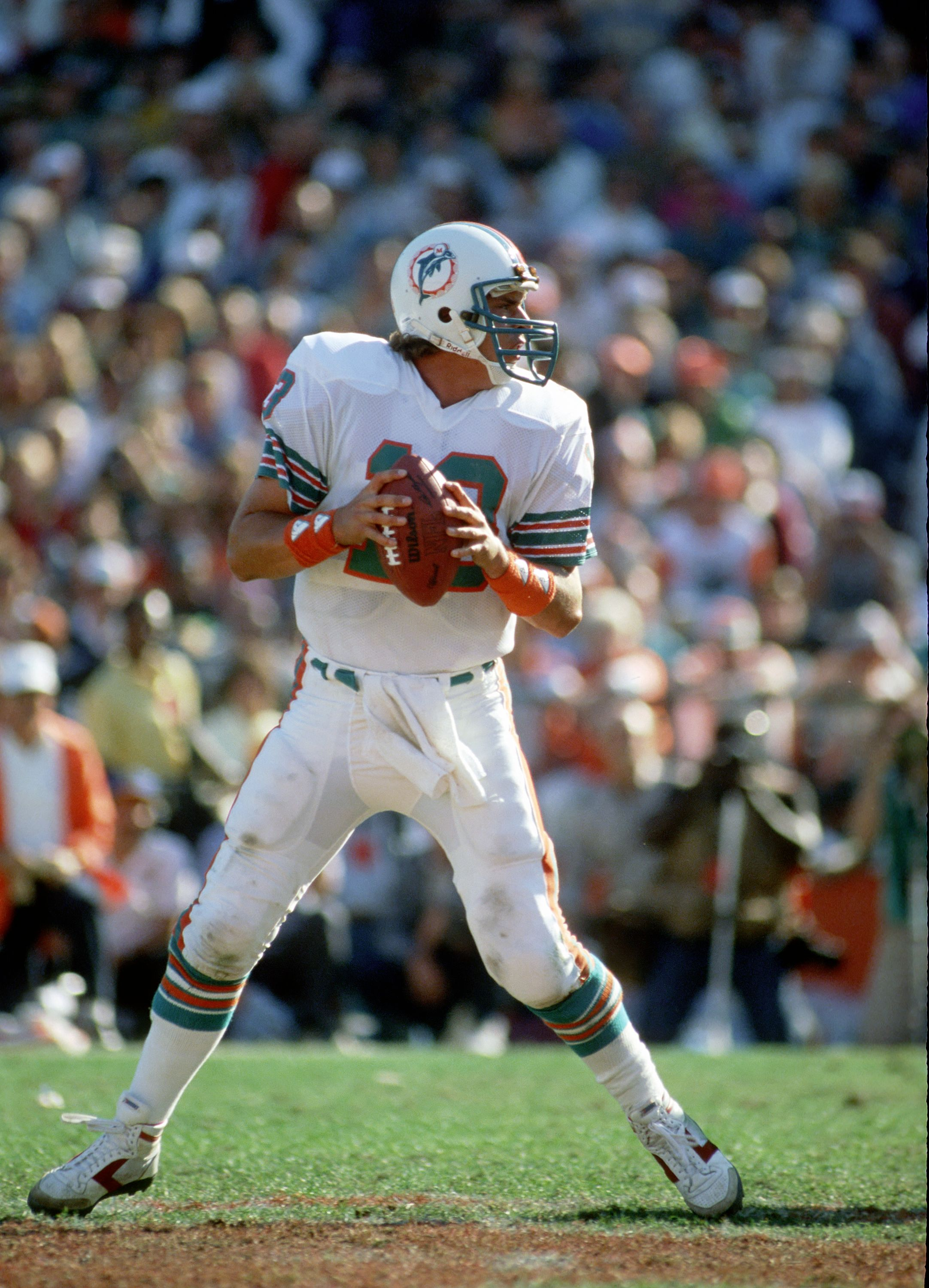 Dan Marino #13 of the Miami Dolphins looks to pass during the 1984 season AFC Championship game against the Pittsburgh Steelers at the Orange Bowl on January 6, 1985 in Miami, Florida. | Source: Getty Images