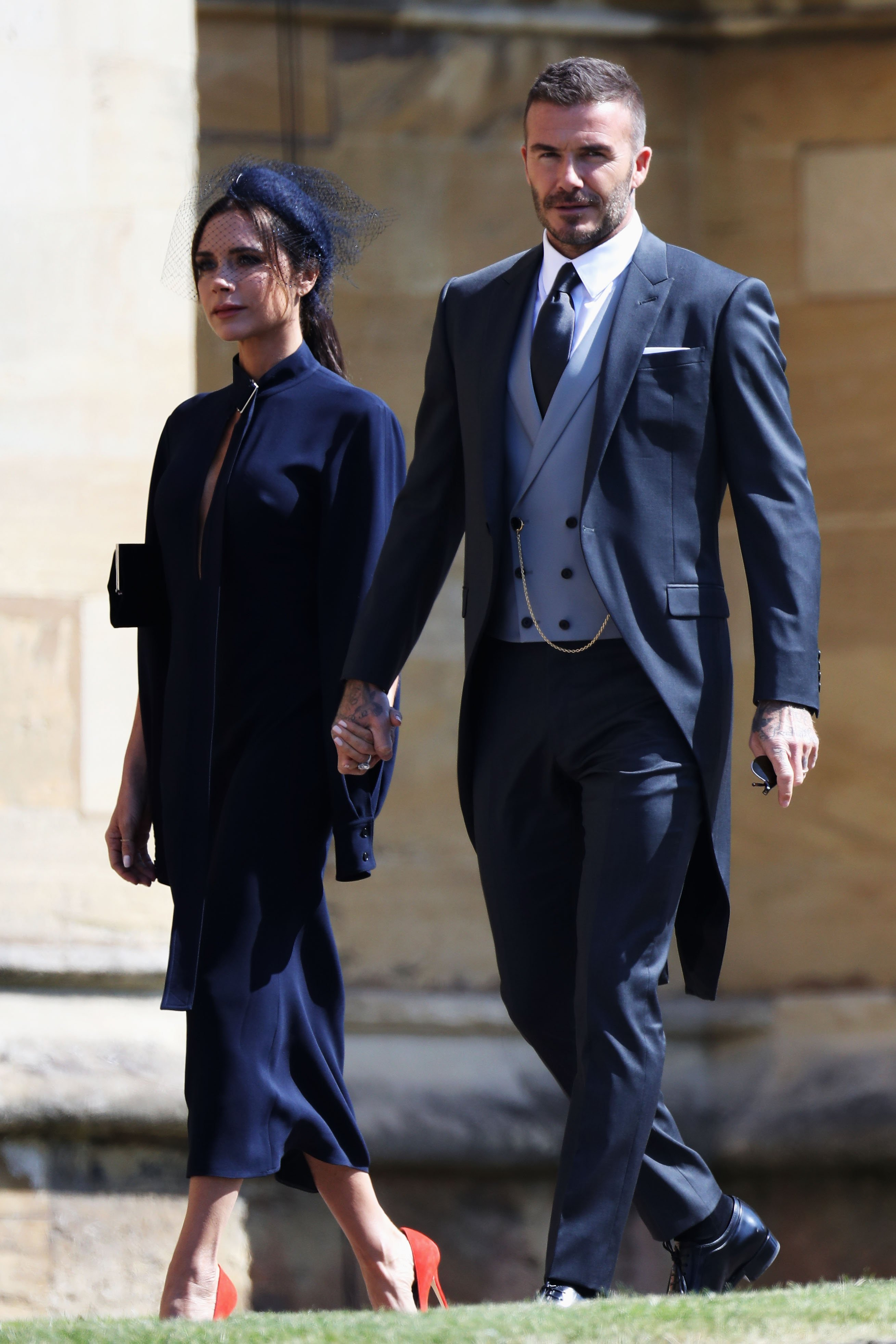 Victoria Beckham and David Beckham arrive at Prince Harry and Meghan Markle's wedding at St George's Chapel, Windsor Castle on May 19, 2018, in Windsor, England. | Source: Getty Images.