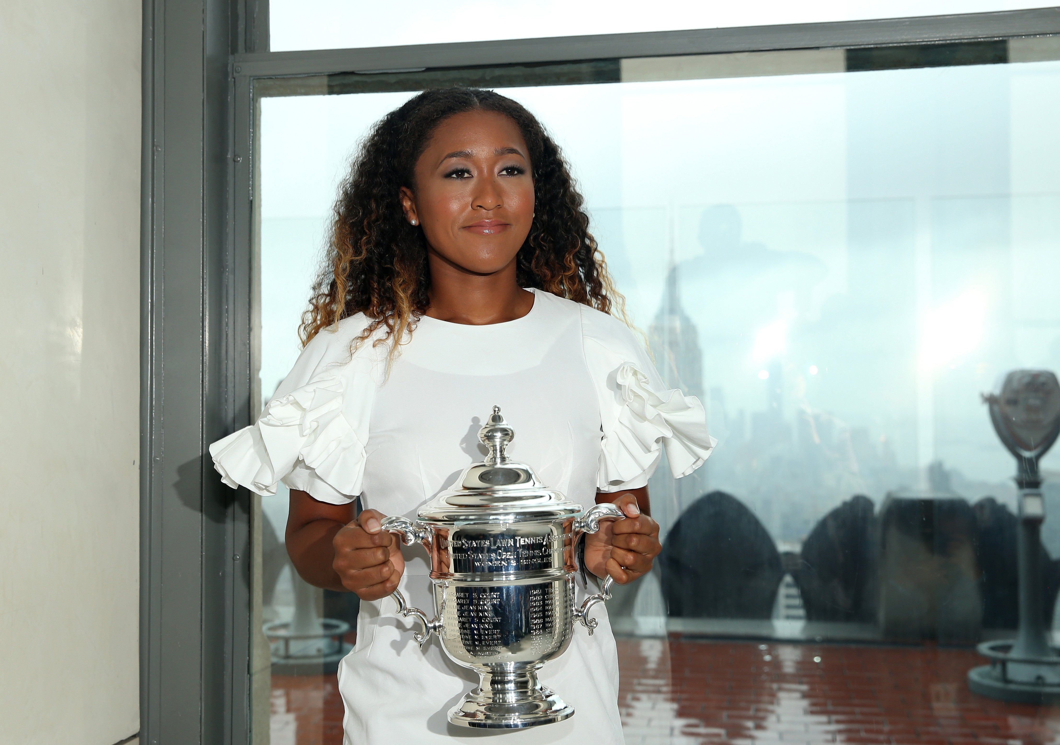 Naomi Osaka of Japan poses with her trophy on Sept. 9, 2018 after winning at the U.S. Open.  Photo: Getty Images