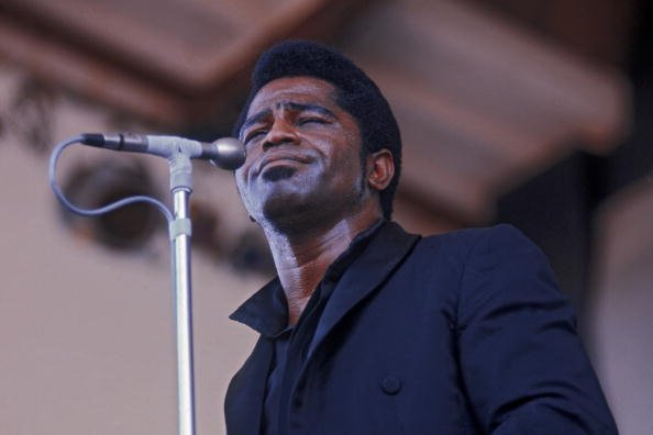 Late American singer, and songwriter James Brown performing at the Newport Jazz Festival in 1968. | Photo: Getty Images