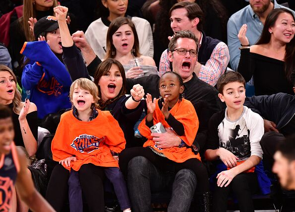 Mariska Hargitay and Peter Hermann sit courtside with children Amaya Hermann, Andrew Hermann and August Hermann at the New York Knicks vs Boston Celtics game  | Getty Images / Global Images Urkaine
