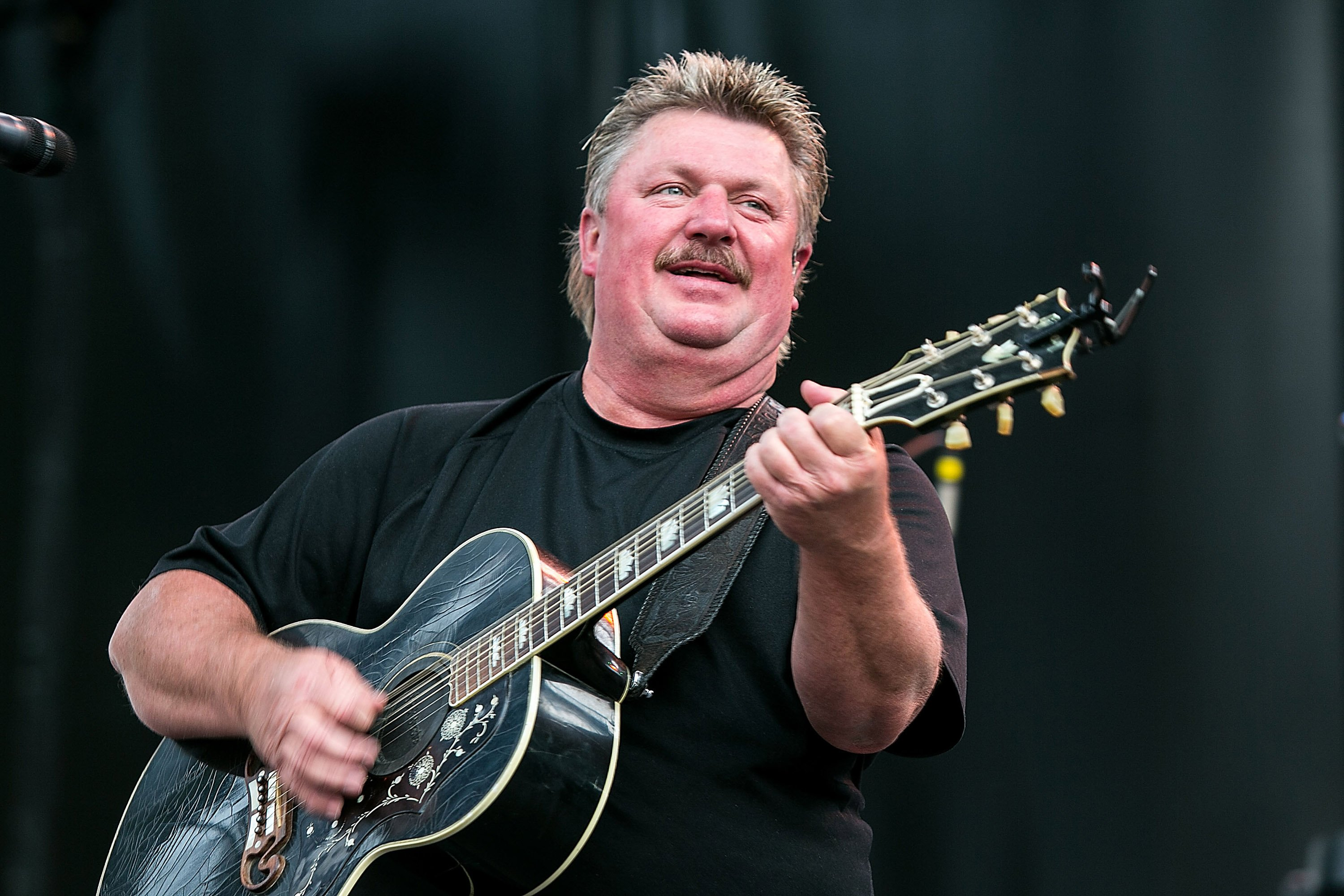 Joe Diffie performs on stage at the Watershed Music Festival 2014 on August 2, 2014, in George, Washington. | Source: Getty Images.