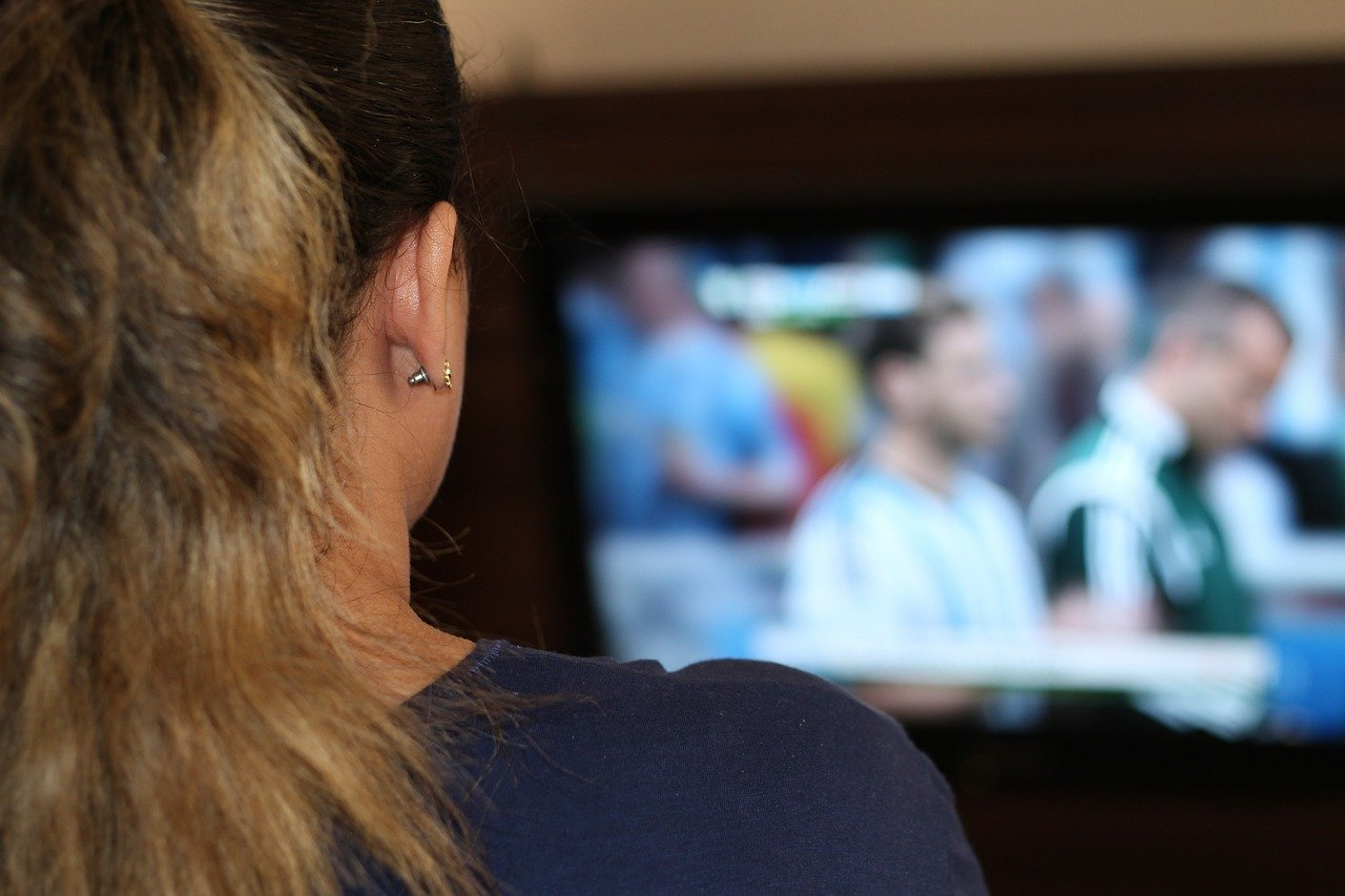 Woman watching TV. Image credit: Pixabay