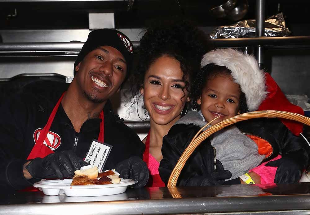 """Nick Cannon and Brittany Bell, with their son Golden Cannon, attend the """"Christmas Celebration On Skid Row"""" at the Los Angeles Mission in December 2019. 