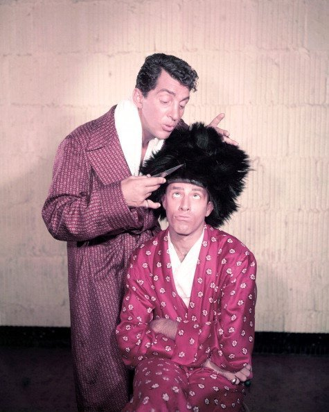 Dean Martin and Jerry Lewis wearing dressing gowns in a studio portrait in 1950. | Photo: Getty Images