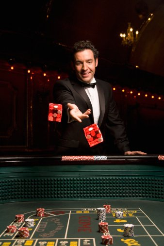 Photo of a man throwing dice in a casino   Photo: Getty Images