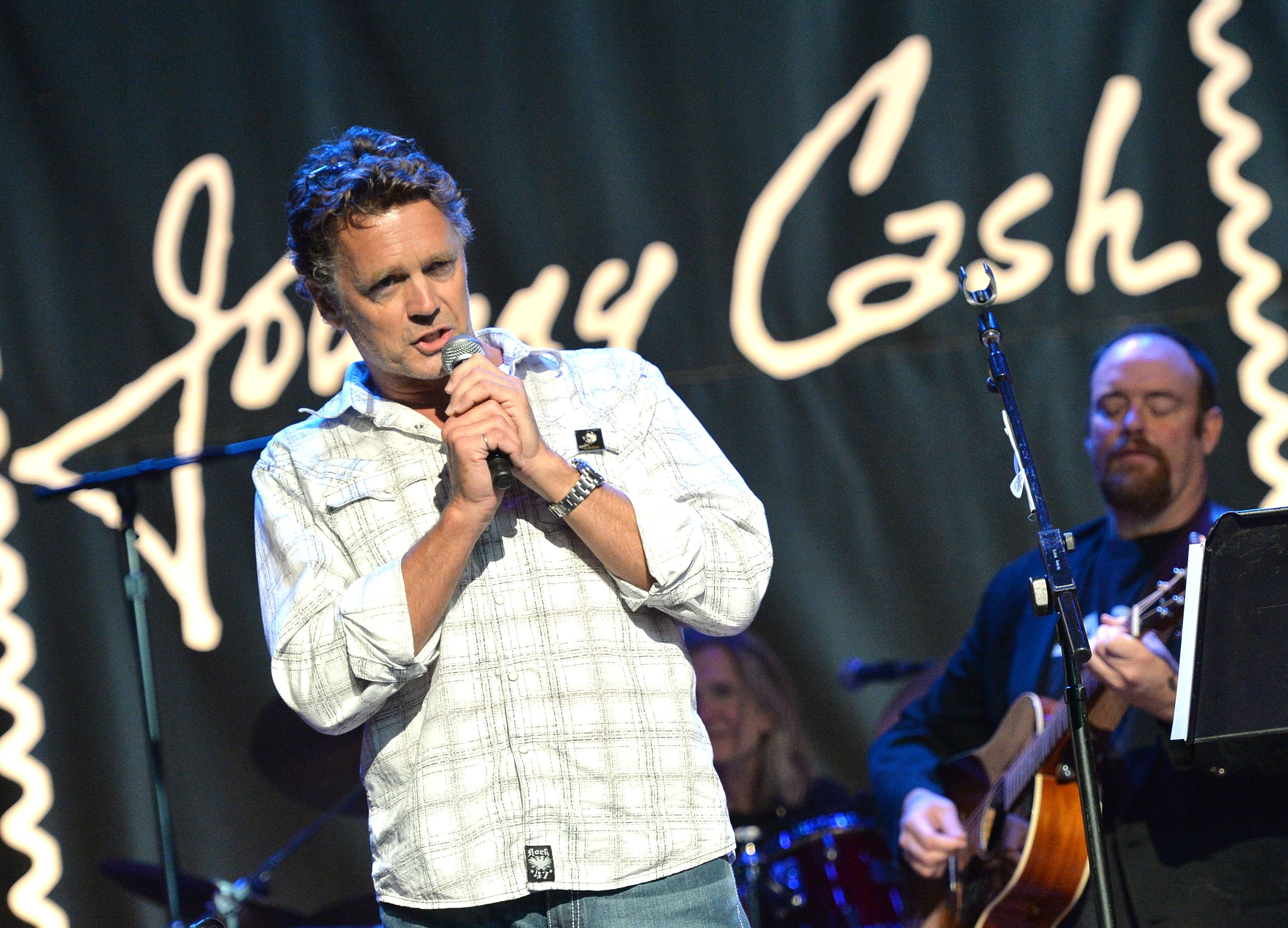 John Schneider and John Carter Cash perform at the Johnny Cash Limited-Edition Forever Stamp launch at Ryman Auditorium on June 5, 2013  | Photo: GettyImages