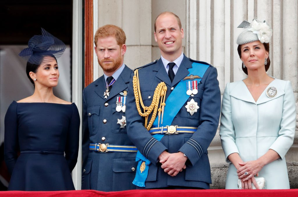 Meghan, Prince Harry, Kate Middleton and Prince William watch a flypast to mark the centenary of the Royal Air Force from the balcony of Buckingham Palace on July 10, 2018. | Photo: Getty Images