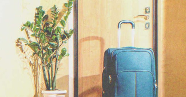 A luggage left by the door. | Source: Shutterstock