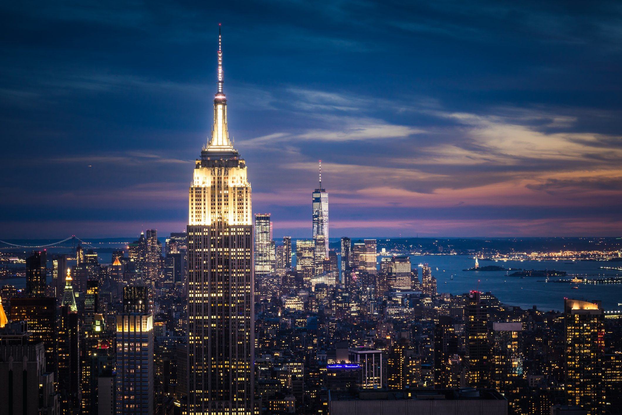 A photo of Empire State Building and New York City skyline at night. | Photo: Getty Images