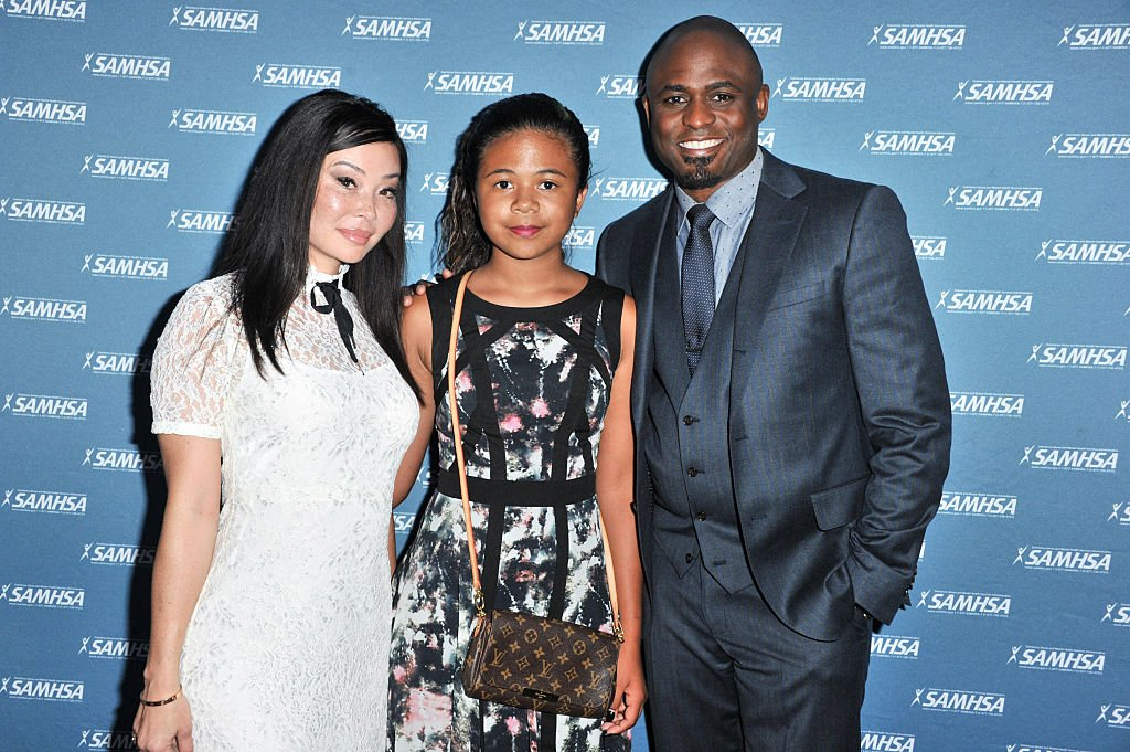 Wayne Brady, his daughter Maile Masako Brady and his ex-wife, Mandie Taketa arrived ay the 10th SAMHSA Voice Awards on August 12, 2015, in Westwood, California | Source: Allen Berezovsky/Getty Images