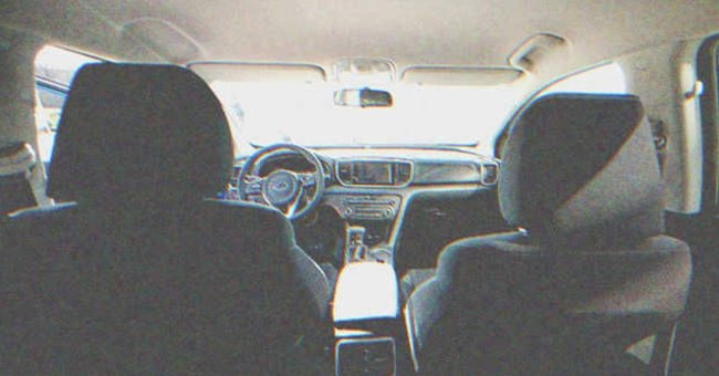 A photo of a car taken from the back seat. | Source: Shutterstock