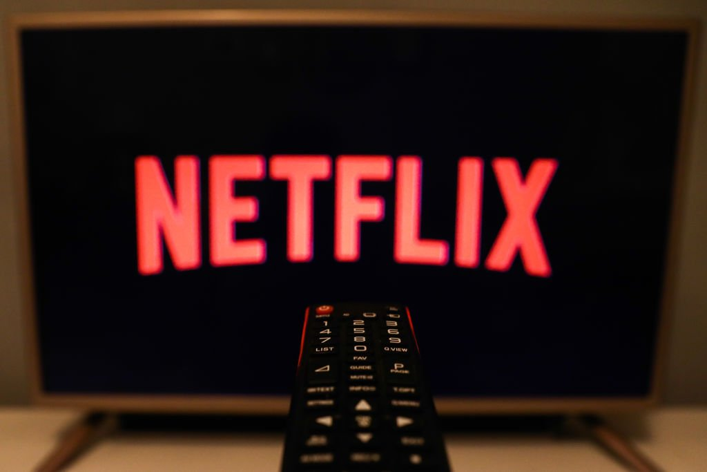 Netflix logo is seen displayed on a TV screen | Photo: Getty Image