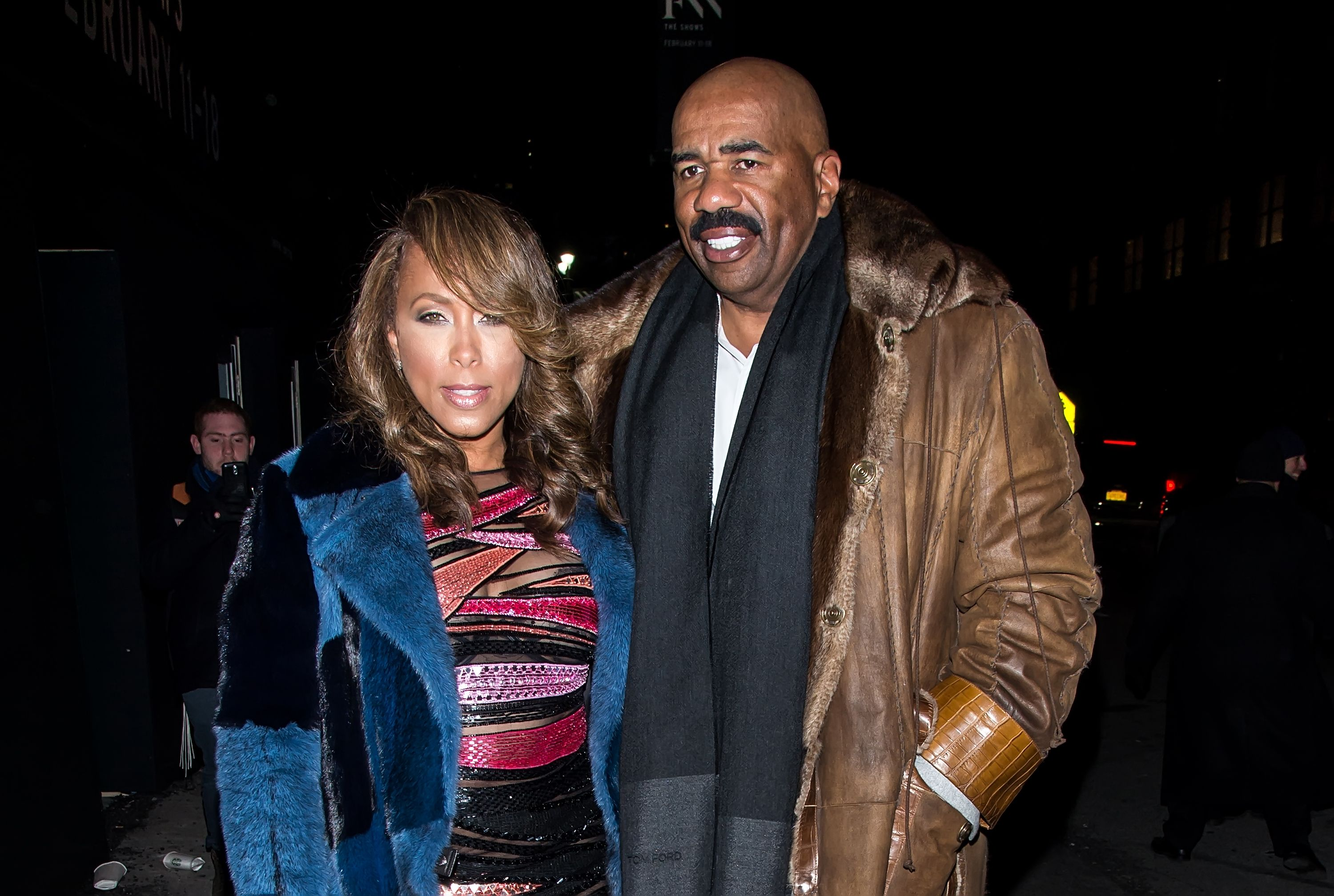Marjorie Harvey and Steve Harvey at the Prabal Gurung Fall 2016 fashion show during New York Fashion Week: The Shows at The Arc, Skylight at Moynihan Station on February 14, 2016. | Photo: Getty Images