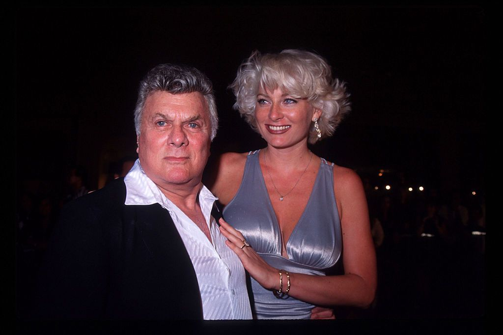 Tony Curtis and wife Jill Vandenberg at the opening of Planet Hollywood in 1995 | Source: Getty Images