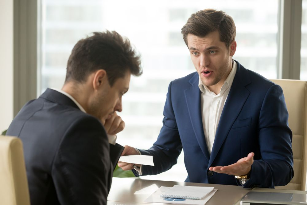 Two men talking about serious matters.   Source: Shutterstock
