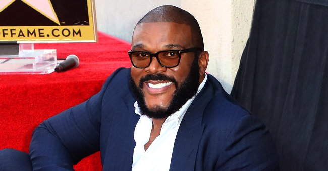Tyler Perry Celebrates His 51st Birthday by Lounging on a Yacht in a White Shirt & Pants