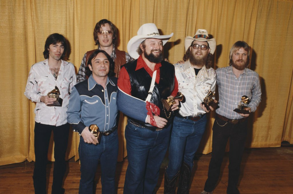 "American country musician Charlie Davids and his band, winners of the Grammy Award for Best Country Vocal Performance for ""The Devil Went Down to Georgia"", pose during The 22nd GRAMMY Awards held on February 27, 1980, at Shrine Auditorium, Los Angeles. 